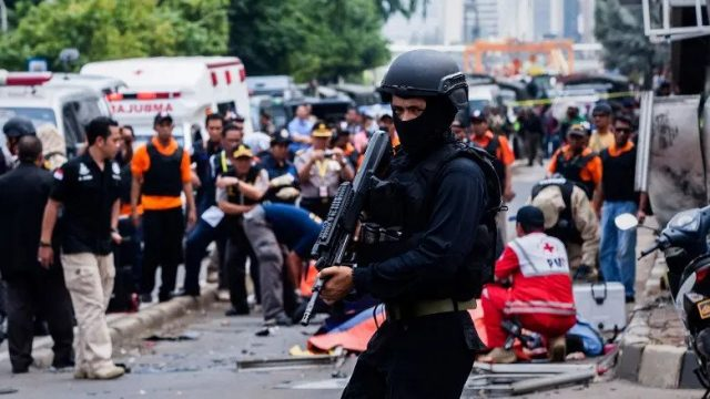 An Indonesian policeman stands guard in front of a blast site in the aftermath of the January 14 Jakarta attacks.